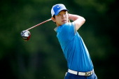 SeungYul Noh of South Korea hits off the sixth tee during the first round of the World Golf ChampionshipsBridgestone Invitational at Firestone...