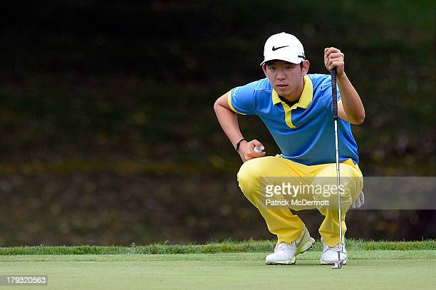 SeungYul Noh of South Korea lines up a putt on the fourth green during the final round of the 2013 Hotel Fitness Championship at Sycamore Hills Golf...
