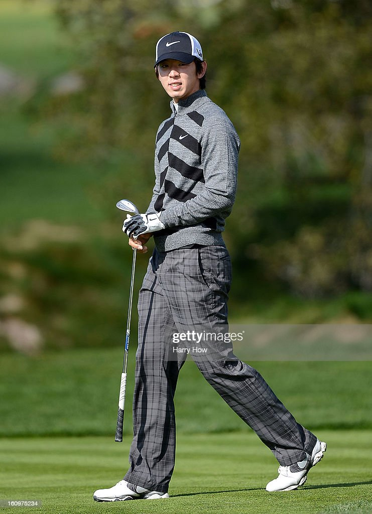 Seung-Yul Noh of South Korea watches his approach shot on the second hole during the second round of the AT&T Pebble Beach National Pro-Am at Pebble Beach Golf Links on February 8, 2013 in Pebble Beach, California.