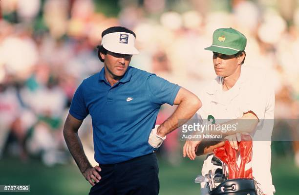 Seve Ballesteros and his caddie read his shot during the 1986 Masters Tournament at Augusta National Golf Club in April 1986 in Augusta Georgia