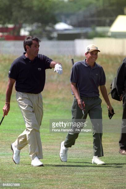 Seve Ballesteros guides fellow Spaniard Sergio Garcia from Valencia through the ins and outs of the Open Competition during their practice round...