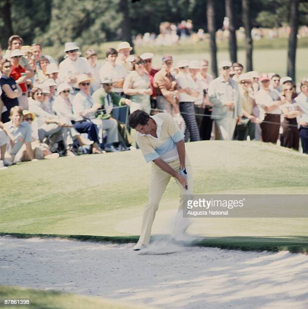 Seve Ballesteros hits from the bunker during the 1977 Masters Tournament at Augusta National Golf Club on April 1977 in Augusta Georgia