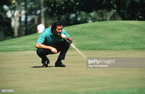 Seve Ballesteros lines up a putt during the 1987 Masters Tournament at Augusta National Golf Club in April 1987 in Augusta Georgia