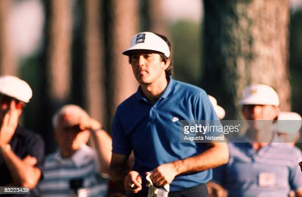 Seve Ballesteros looks away from the sun in front of a small gallery during the 1986 Masters Tournament at Augusta National Golf Club in April 1986...