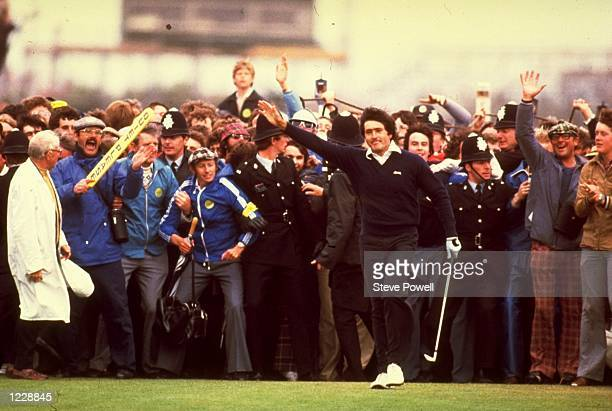 Seve Ballesteros of Spain acknowledges the crowd after holing his putt on the 18th green to win the British Open at the Royal Lytham Golf Club in...