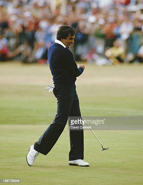 Seve Ballesteros of Spain celebrates after he holes out on the final 18th green to win the 113th Open Championship on 22nd July 1984 on the Old...