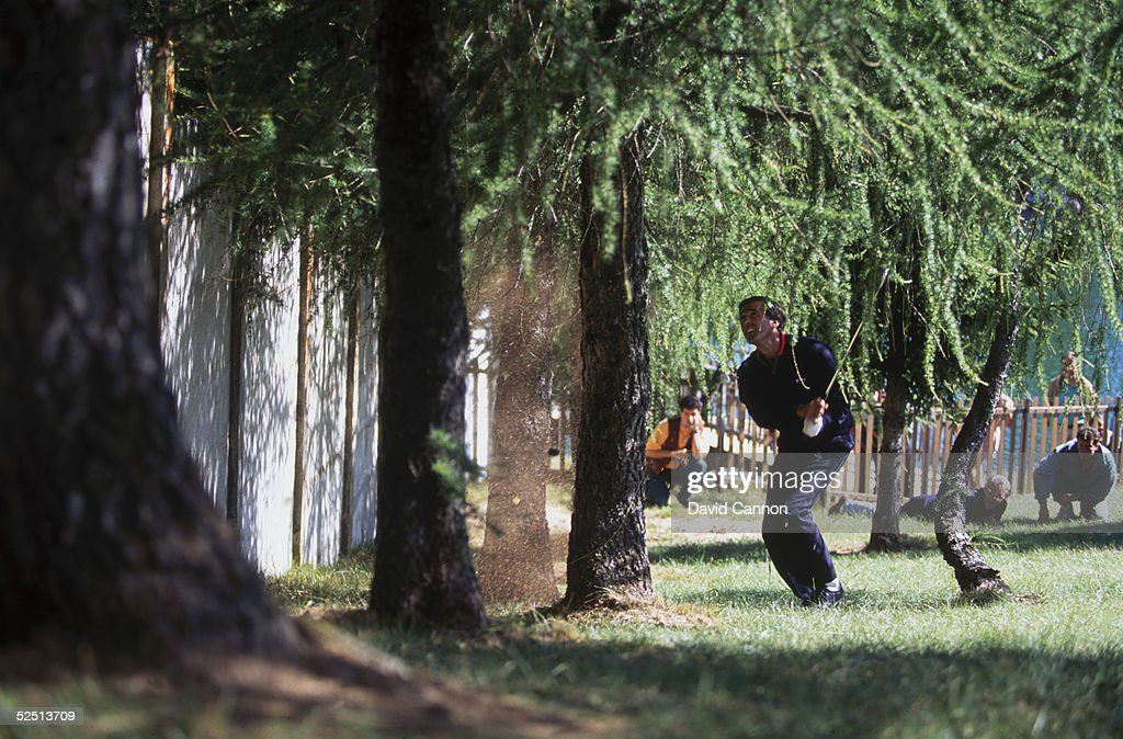 Seve Ballesteros of Spain plays a miracle shot on the 18th hole to set up a birdie finish during the final round of the European Masters at Crans Sur...