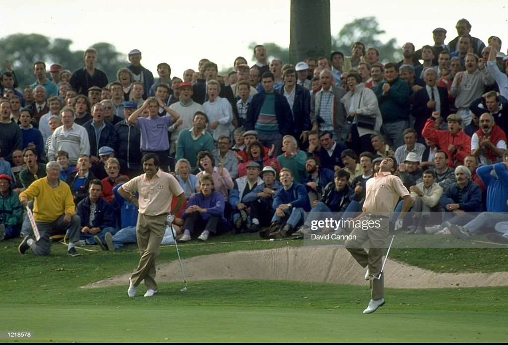 Seve Ballesteros of Spain watches as JoseMaria Olazabal misses his putt on the 10th green during the Ryder Cup at The Belfry Golf Cub in Sutton...