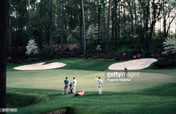 Seve Ballesteros waits as Larry Mize putts on the 13th green during the 1987 Masters Tournament at Augusta National Golf Club in April 1987 in...