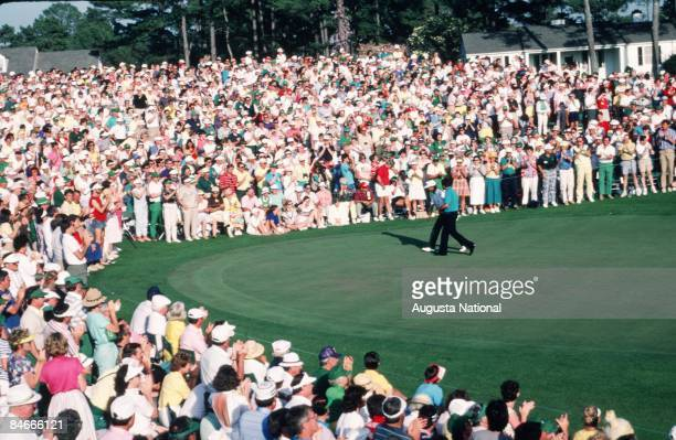 Seve Ballesteros walks off the 18th green with T C Chen in front of a large gallery during the 1987 Masters Tournament at Augusta National Golf Club...