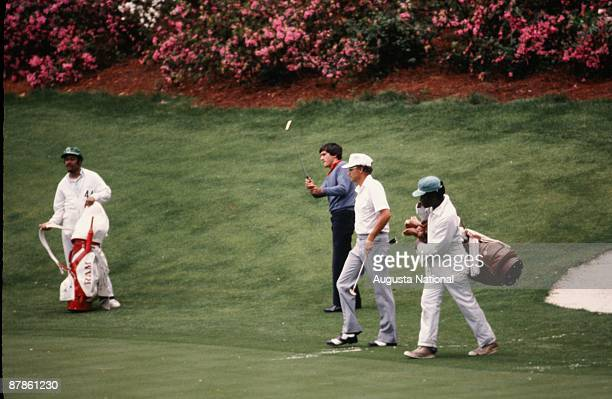 Seve Ballesteros watches his putt alongside Tommy Aaron during the 1979 Masters Tournament at Augusta National Golf Club on April 1979 in Augusta...