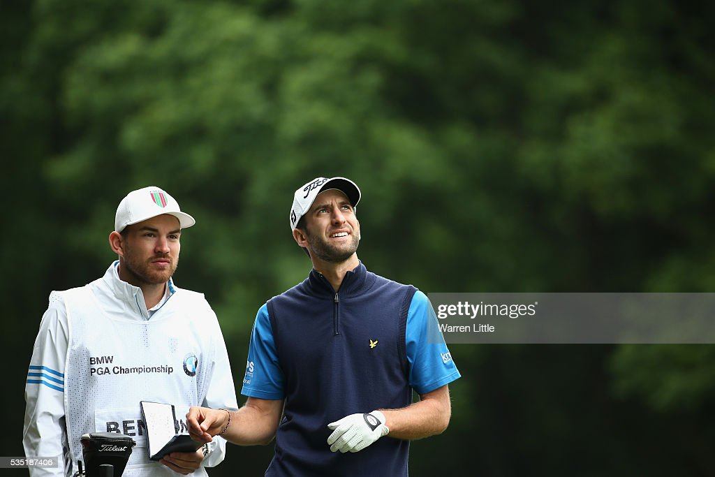 Seve Benson of England looks on with his caddie on the 3rd tee during day four of the BMW PGA Championship at Wentworth on May 29, 2016 in Virginia Water, England.