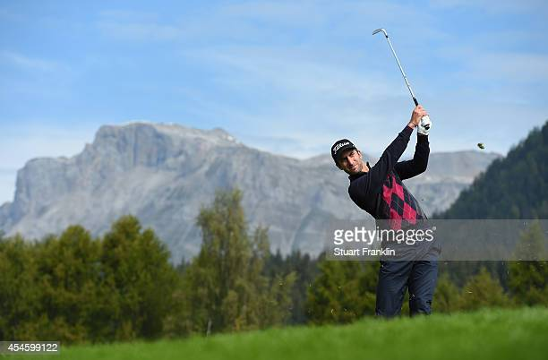 Seve Benson of England plays a shot during the first round of the Omega European Masters at CranssurSierre Golf Club on September 4 2014 in...