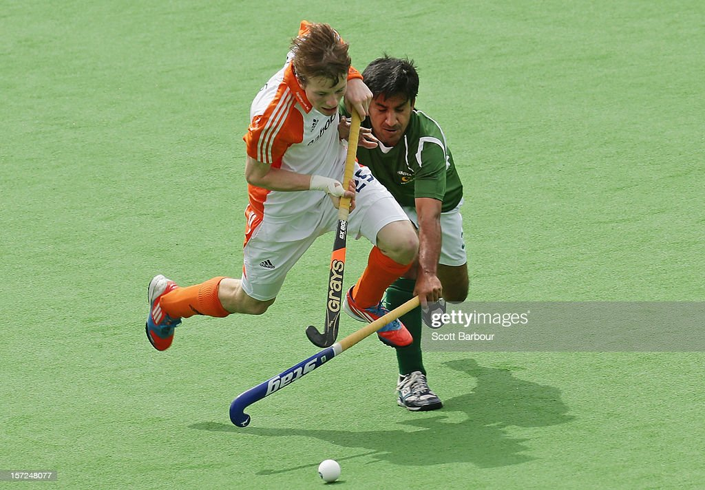 Seve van Ass of the Netherlands is tackled during the match between the Netherlands and Pakistan on day one of the Champions Trophy on December 1, 2012 in Melbourne, Australia.