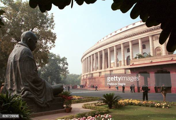 Seven civilians and five terrorists were killed in a suicide attack on the Indian Parliament The statue of the apostle of peace Mahatma Gandhi looks...