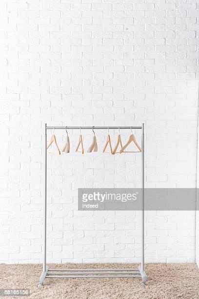 Seven empty hangers on rack
