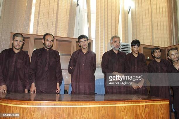 Seven men who gangraped four women on August 23 stand in court in Kabul Afghanistan on September 7 2014 Afghanistan handed the death penalty to seven...