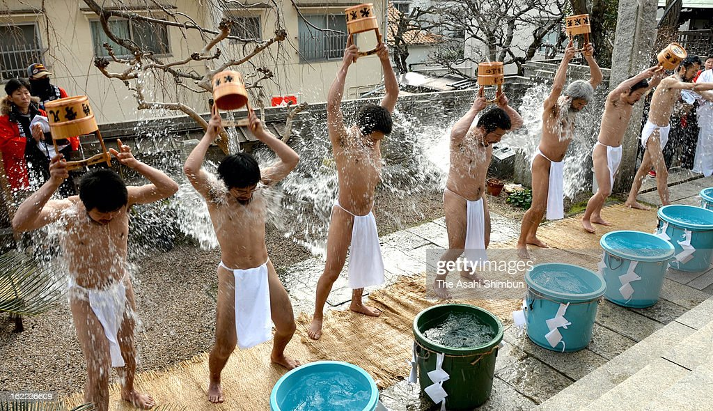 Seven monks, who completed the hundred days ascetic training, splash water to purify their souls at Gokokuji Temple on February 17, 2013 in Shimonoseki, Yamaguchi, Japan.