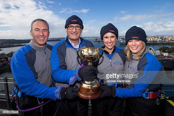 Seven Network Sunrise team Mark Beretta David Koch Natalie Barr and Samantha Armytage pose with the Melbourne Cup trophy during the Melbourne Cup...