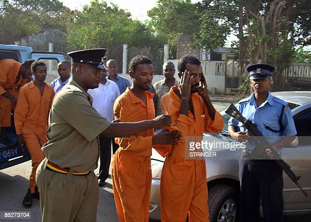 Seven Somalian pirates are led to court by Kenyan police officers on March 6 2009 at the port town of Mombasa US Naval vessel VSS Leyte Gulf...