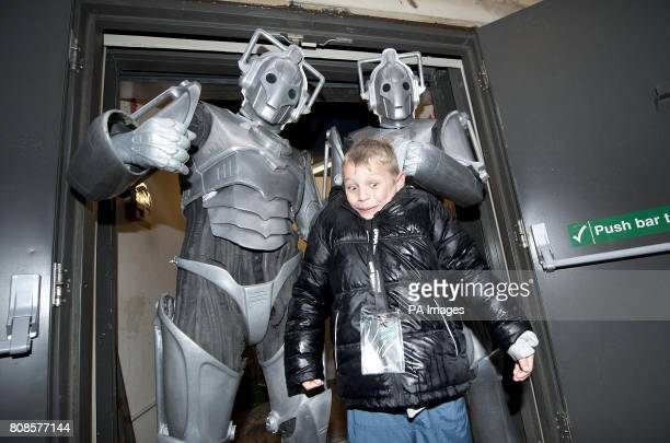 Seven year old Dr Who fan Tyler Scott is visited by two Cybermen as he queues outside HMV in Oxford St for a signing session for the programme's new...
