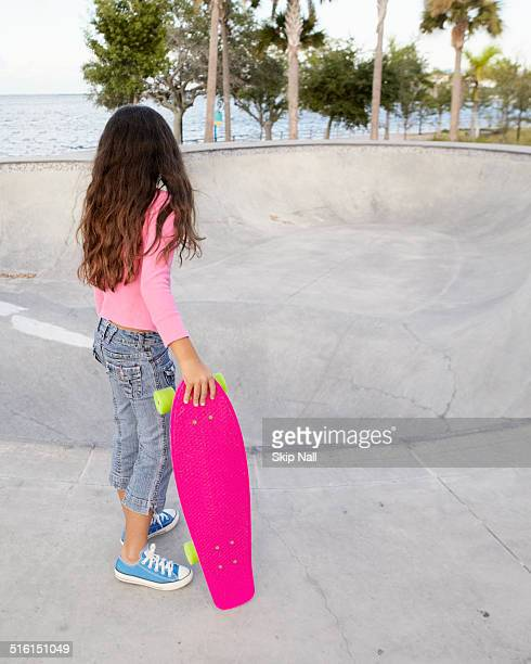 Seven year old girl with skateboard