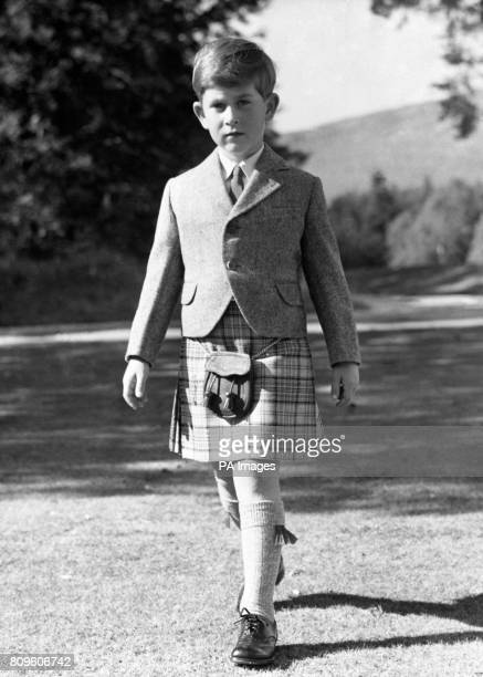 Seven year old Prince Charles striding through the grounds of Balmoral Castle Scotland in a kilt of the Balmoral tartan