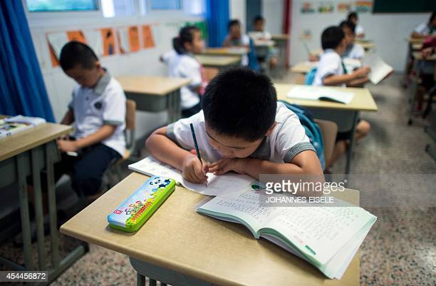 Seven year old Wei Yueran who also has the English name Harney attends a Chinese class at the Jinqao Center Primary School in Shanghai on September 1...