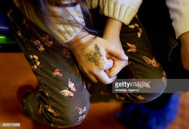 A seven years old Syrian girl Bana Alabed is seen with a butterfly painting on her hand at Turkish Red Crescent Community Center in Altindag district...