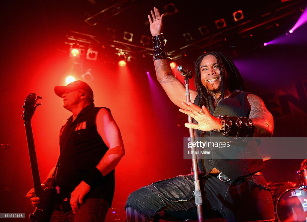 Sevendust bassist Vince Hornsby (L) and singer Lajon Witherspoon perform at the Railhead at the Boulder Station Hotel & Casino as the band tours in support of the new album 'Black Out the Sun' on March 23, 2013 in Las Vegas, Nevada.