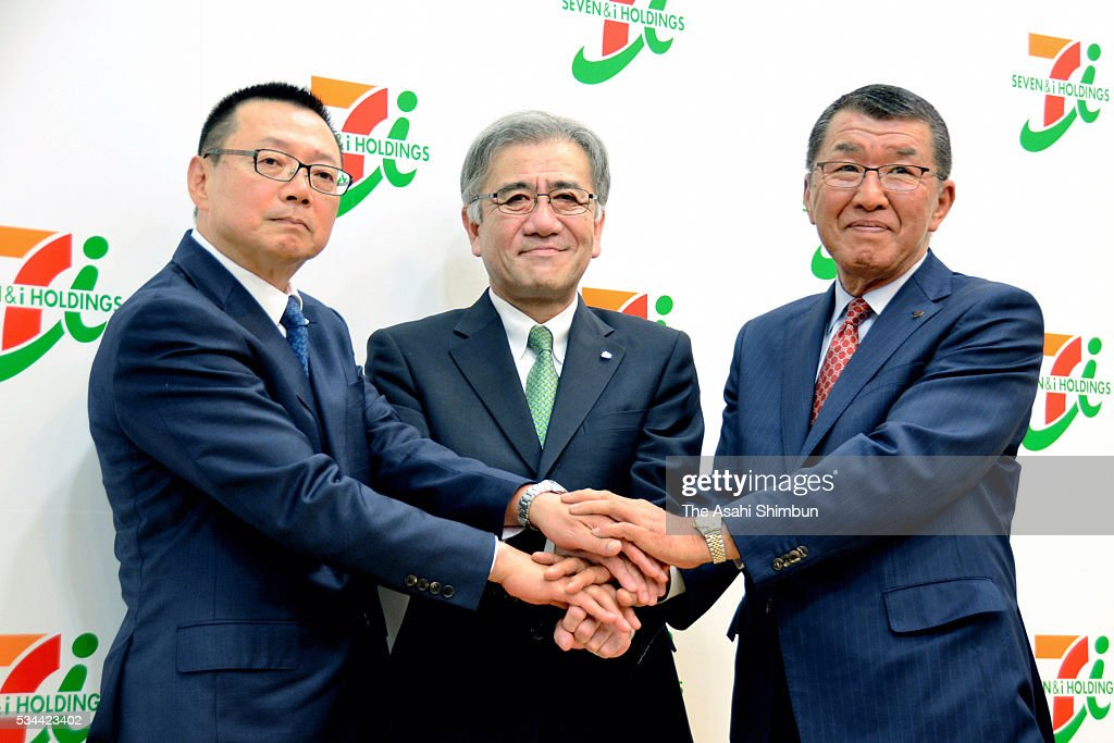 Seven&i Holdings Vice President Katsuhiro Goto, President Ryuichi Isaka and Seven-Eleven Japan President Kazuki Furuya pose for photohgraphs during a press conference after the annual shareholders meeting on May 26, 2016 in Tokyo, Japan.
