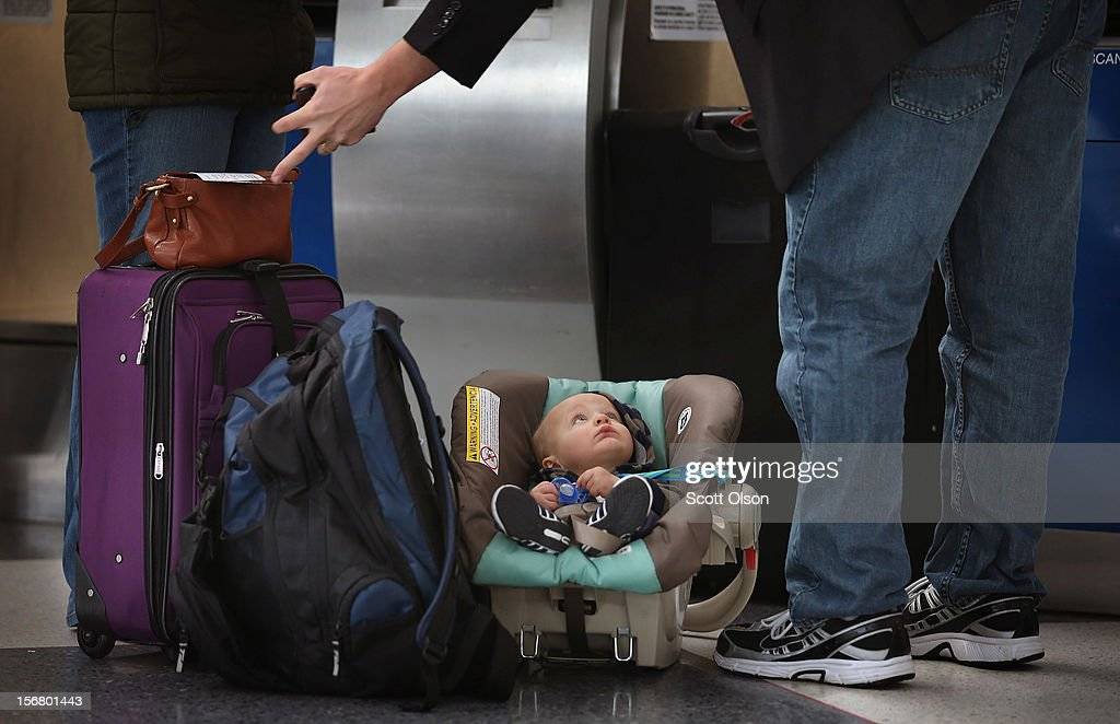 Seven-month-old Evan Witkowski relaxes while his parents Brian and Kate check in for their flight at O'Hare International Airport on November 21, 2012 in Chicago, Illinois. The family was flying to Kingston, New York to spend the Thanksgiving holiday with family. The Chicago Department of Aviation anticipates nearly 1.8 million passengers will travel through Chicago's two airports for the Thanksgiving holiday travel period between Tuesday, November 20 and Tuesday November 27.