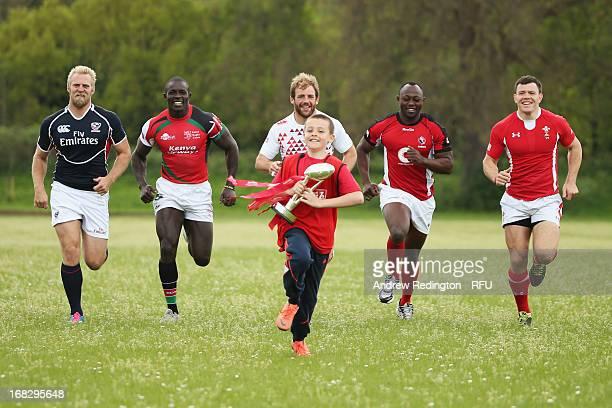 Sevens captains Matt Hawkins of USA Nanyak Dala of Canada Rob Vickerman of England Andrew Amonde of Kenya and Adam Thomas of Wales chase ten year old...