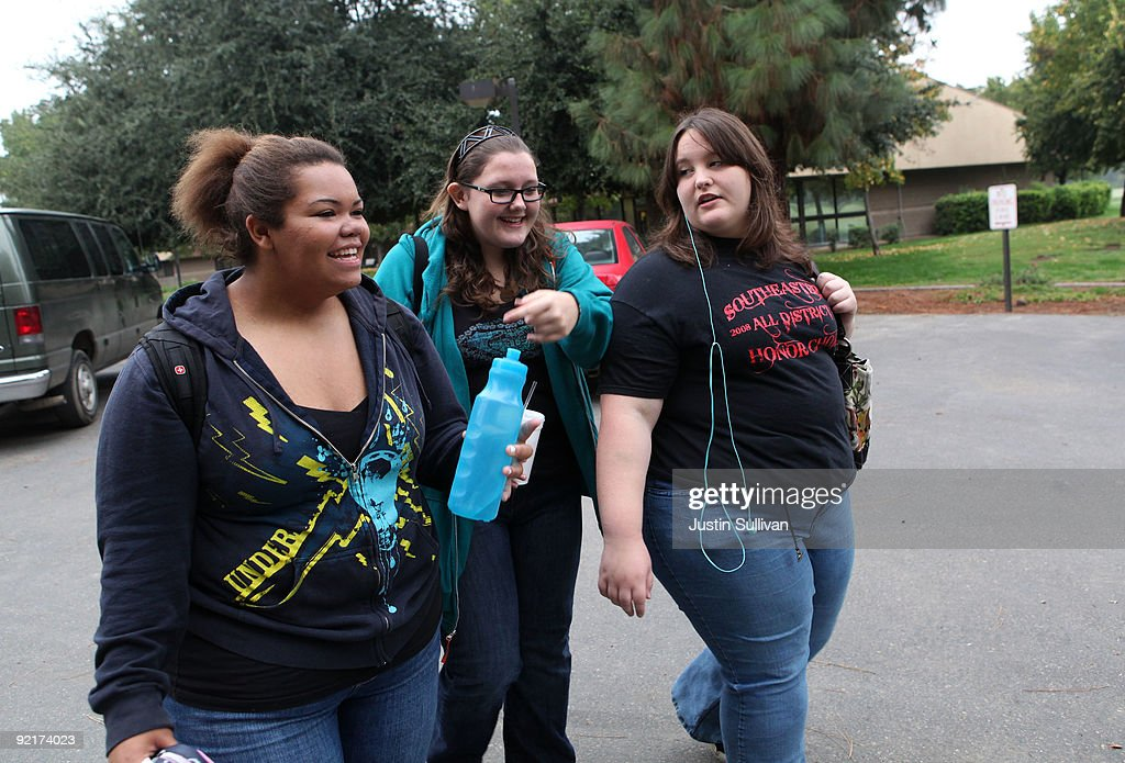 Seventeen year-old Marissa Hamilton (L) laughs with her friends Mary Healy (C) and Makayla Smith (L) as they walk to class at Wellspring Academy October 20, 2009 in Reedley, California. Struggling with her weight, seventeen year-old Marissa Hamilton enrolled at the Wellspring Academy, a special school that helps teens and college level students lose weight along with academic courses. When Marissa first started her semester at Wellspring she weighed in at 340 pounds and has since dropped over 40 pounds of weight in the first two months of the program. According to the Centers for Disease Control and Prevention, 16 percent of children in the US ages 6-19 years are overweight or obese, three times the amount since 1980.
