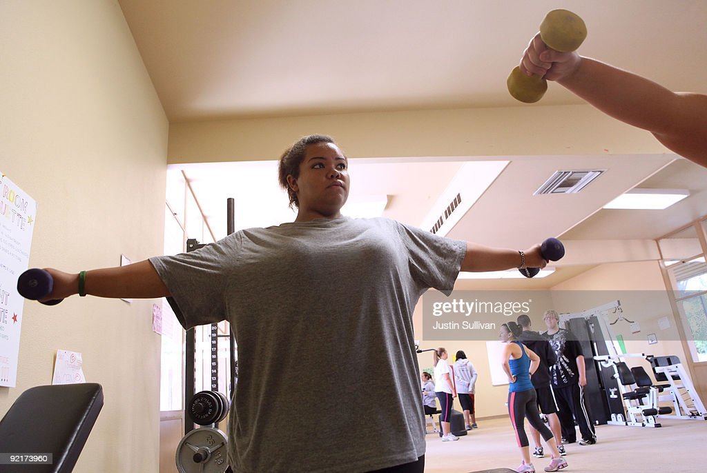 Seventeen year-old Marissa Hamilton lifts weights during a fitness class at Wellspring Academy October 19, 2009 in Reedley, California. Struggling with her weight, seventeen year-old Marissa Hamilton enrolled at the Wellspring Academy, a special school that helps teens and college level students lose weight along with academic courses. When Marissa first started her semester at Wellspring she weighed in at 340 pounds and has since dropped over 40 pounds of weight in the first two months of the program. According to the Centers for Disease Control and Prevention, 16 percent of children in the US ages 6-19 years are overweight or obese, three times the amount since 1980.
