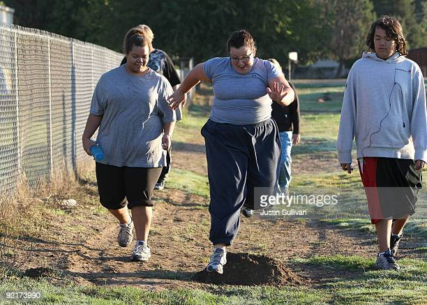 Seventeen yearold Marissa Hamilton looks on as her friend Elizabeth Fedorchalk leaps over a mound of dirt during a morning walk at Wellspring Academy...