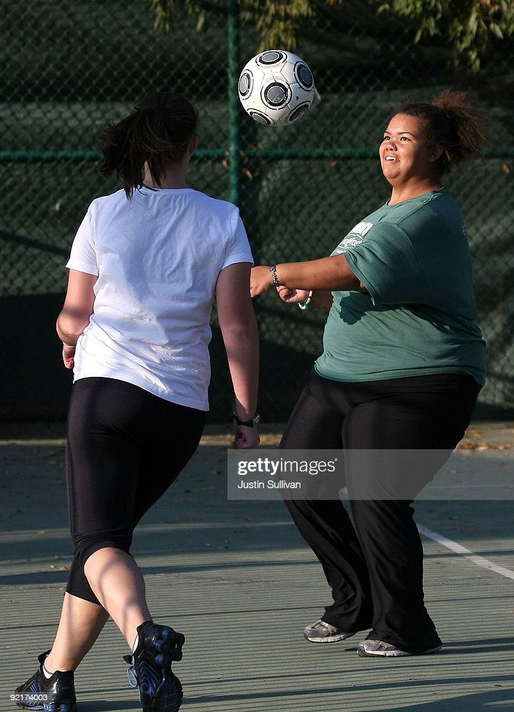 Seventeen year-old Marissa Hamilton (R) plays soccer during fitness training at Wellspring Academy October 20, 2009 in Reedley, California. Struggling with her weight, seventeen year-old Marissa Hamilton enrolled at the Wellspring Academy, a special school that helps teens and college level students lose weight along with academic courses. When Marissa first started her semester at Wellspring she weighed in at 340 pounds and has since dropped over 40 pounds of weight in the first two months of the program. According to the Centers for Disease Control and Prevention, 16 percent of children in the US ages 6-19 years are overweight or obese, three times the amount since 1980.