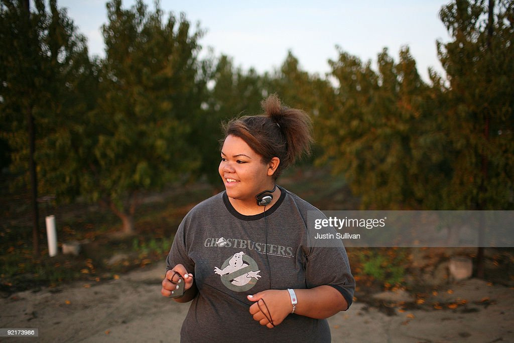 Seventeen year-old Marissa Hamilton smiles before doing a one mile run at Wellspring Academy October 21, 2009 in Reedley, California. Struggling with her weight, seventeen year-old Marissa Hamilton enrolled at the Wellspring Academy, a special school that helps teens and college level students lose weight along with academic courses. When Marissa first started her semester at Wellspring she weighed in at 340 pounds and has since dropped over 40 pounds of weight in the first two months of the program. According to the Centers for Disease Control and Prevention, 16 percent of children in the US ages 6-19 years are overweight or obese, three times the amount since 1980.