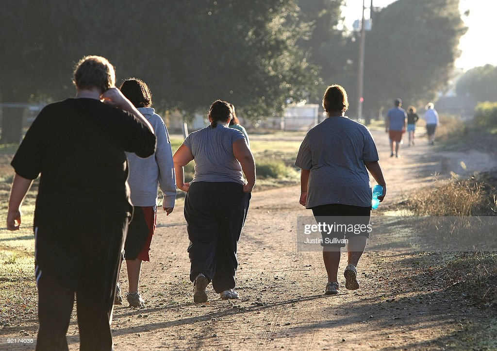 Seventeen year-old Marissa Hamilton (R) walks with friends during a morning walk at Wellspring Academy October 19, 2009 in Reedley, California. Struggling with her weight, seventeen year-old Marissa Hamilton enrolled at the Wellspring Academy, a special school that helps teens and college level students lose weight along with academic courses. When Marissa first started her semester at Wellspring she weighed in at 340 pounds and has since dropped over 40 pounds of weight in the first two months of the program. According to the Centers for Disease Control and Prevention, 16 percent of children in the US ages 6-19 years are overweight or obese, three times the amount since 1980.