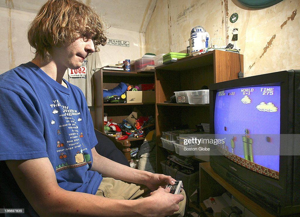 Seventeen-year-old Andrew Gardikis, a Super Mario champ, plays the video game in his room.