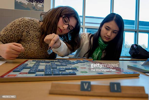 Seventh graders Eliana Rosenthal left and Lucy Levenson play scrabble in a club at Alice Deal Middle School in Washington DC on December 15 2014 The...