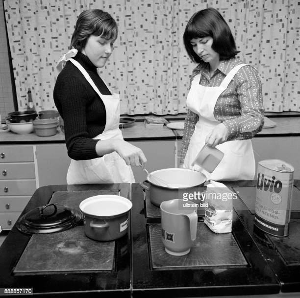 Seventies black and white photo people physical handicap school school lessons cooking instruction schoolmistress 25 to 35 years and schoolgirl 12 to...