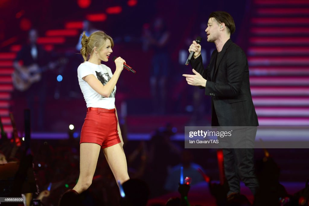 Seven-time Grammy winner <a gi-track='captionPersonalityLinkClicked' href=/galleries/search?phrase=Taylor+Swift&family=editorial&specificpeople=619504 ng-click='$event.stopPropagation()'>Taylor Swift</a> was joined on stage by <a gi-track='captionPersonalityLinkClicked' href=/galleries/search?phrase=Danny+O%27Donoghue&family=editorial&specificpeople=5598563 ng-click='$event.stopPropagation()'>Danny O'Donoghue</a> on the third night of the European leg of her blockbuster The RED Tour with the third of five sold-out shows at London's O2 Arena, playing to a capacity crowd of more than 15500 fans on February 4, 2014 in London, England.