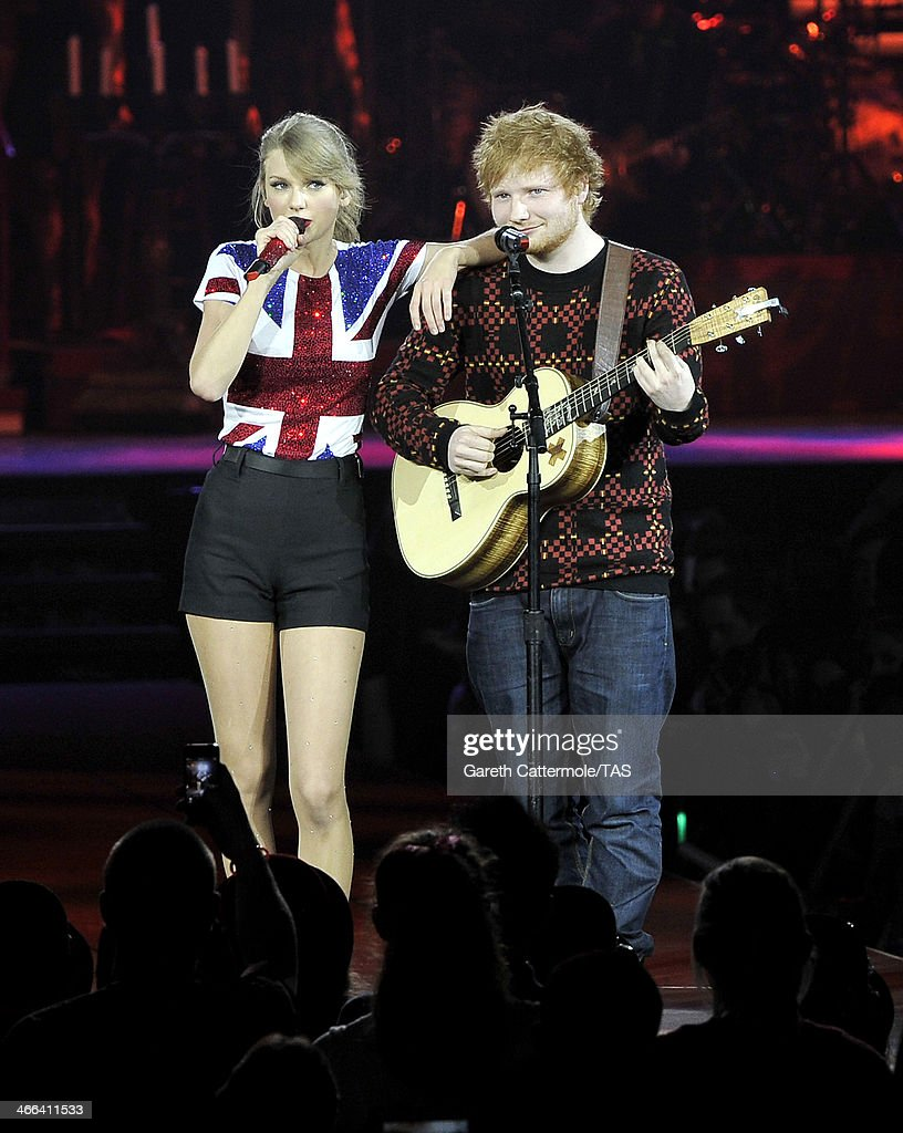 Seven-time Grammy winner <a gi-track='captionPersonalityLinkClicked' href=/galleries/search?phrase=Taylor+Swift&family=editorial&specificpeople=619504 ng-click='$event.stopPropagation()'>Taylor Swift</a> was joined on stage by <a gi-track='captionPersonalityLinkClicked' href=/galleries/search?phrase=Ed+Sheeran&family=editorial&specificpeople=7604356 ng-click='$event.stopPropagation()'>Ed Sheeran</a> as she kicked off the European leg of her blockbuster The RED Tour with the first of five sold-out shows at London's O2 Arena, playing to a capacity crowd of more than 15500 fans, on February 1, 2014 in London, England.