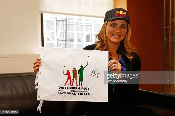 Seventime LPGA winner Lexi Thompson poses with a signed Drive Chip and Putt flag prior to an appearance on ESPN on March 14 2016 in New York City...
