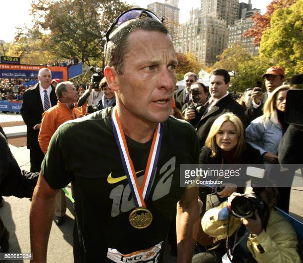 Seventime Tour de France champion Lance Armstrong crosses the finish line at the 2006 ING New York City Marathon 05 November 2006 This was...