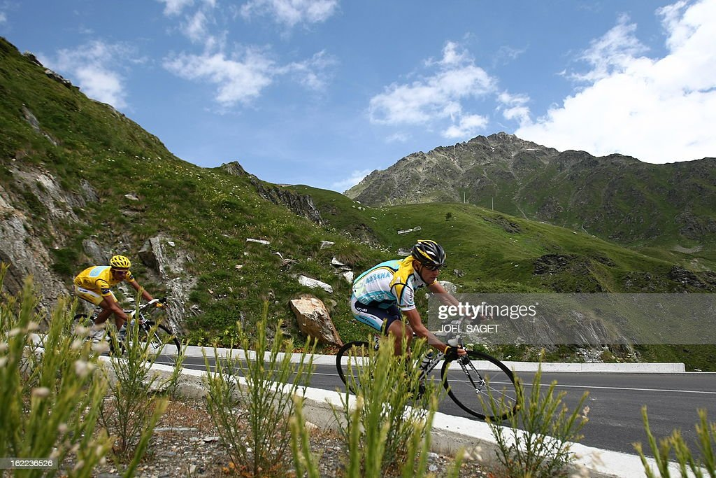 Seventime Tour de France winner and Kazakh cycling team Astana 's Lance Armstrong of the United States rides with yellow jersey of overall leader...
