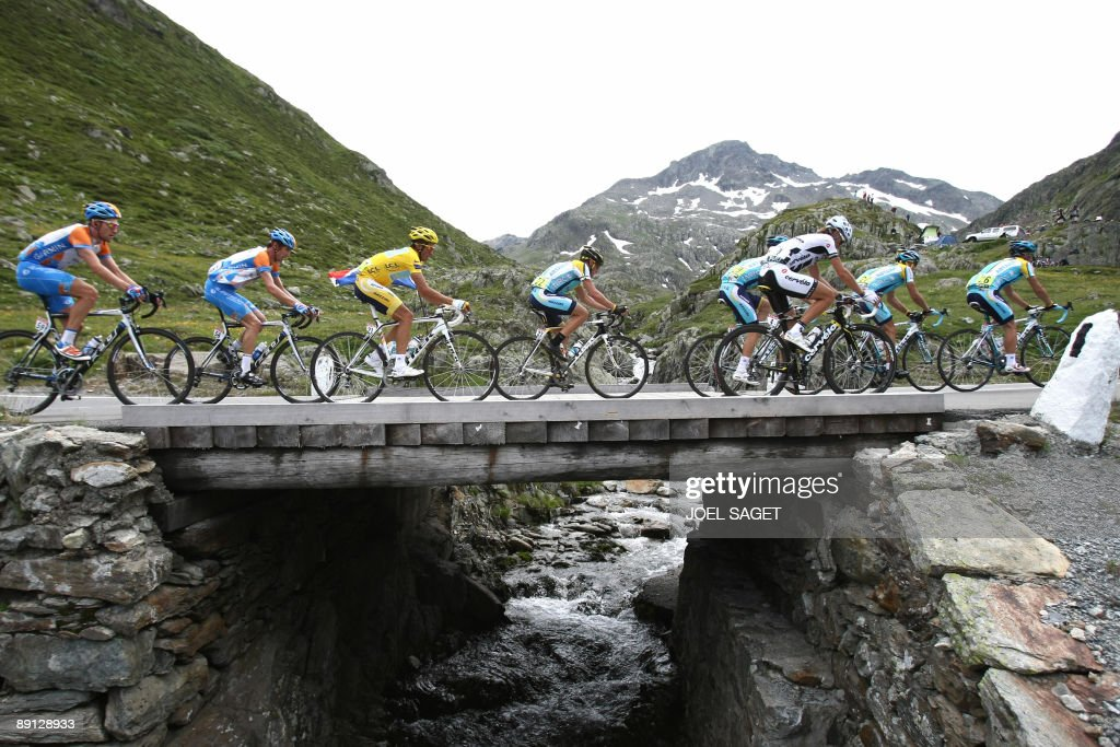 Seventime Tour de France winner and Kazakh cycling team Astana 's Lance Armstrong of the United States rides in the pack with yellow jersey of...