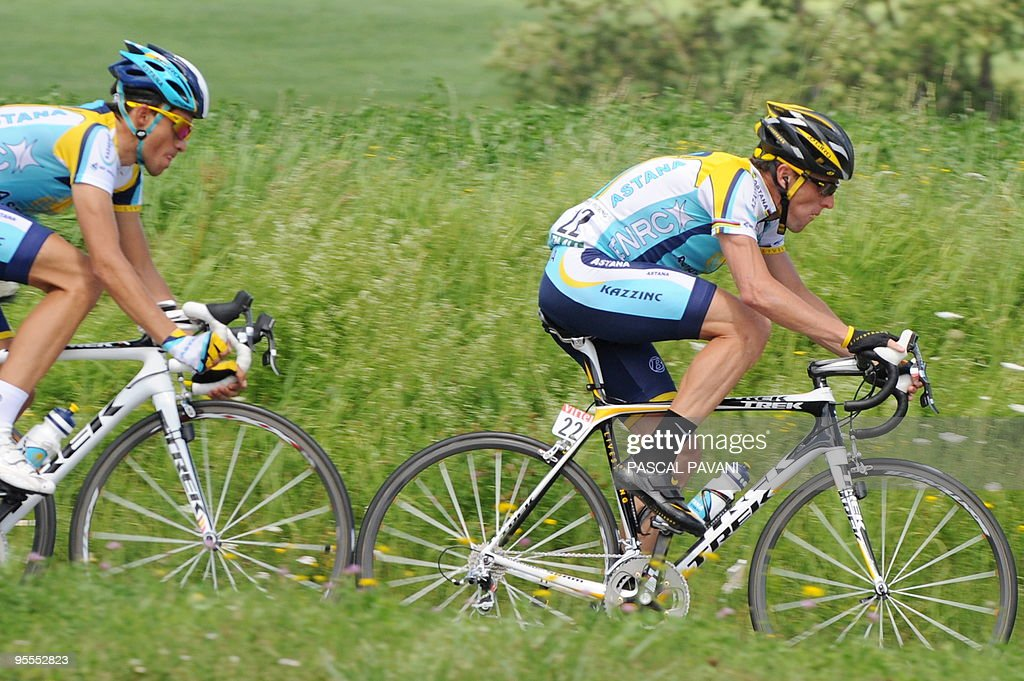 Seven-time Tour de France winner and Kazakh cycling team Astana (AST)'s Lance Armstrong of the United States (R) rides with teammate, 2007 Tour de France winner Alberto Contador of Spain on July 19, 2009 in the 207,5 km and fifteenth stage of the 2009 Tour de France cycling race run between Pontarlier and Verbier (Switzerland). AFP PHOTO PASCAL PAVANI