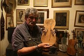 Seventysixyearold Israeli violin maker Amnon Weinstein holds a violin that survived the Second World War bearing German writing and a Nazi Swastika...